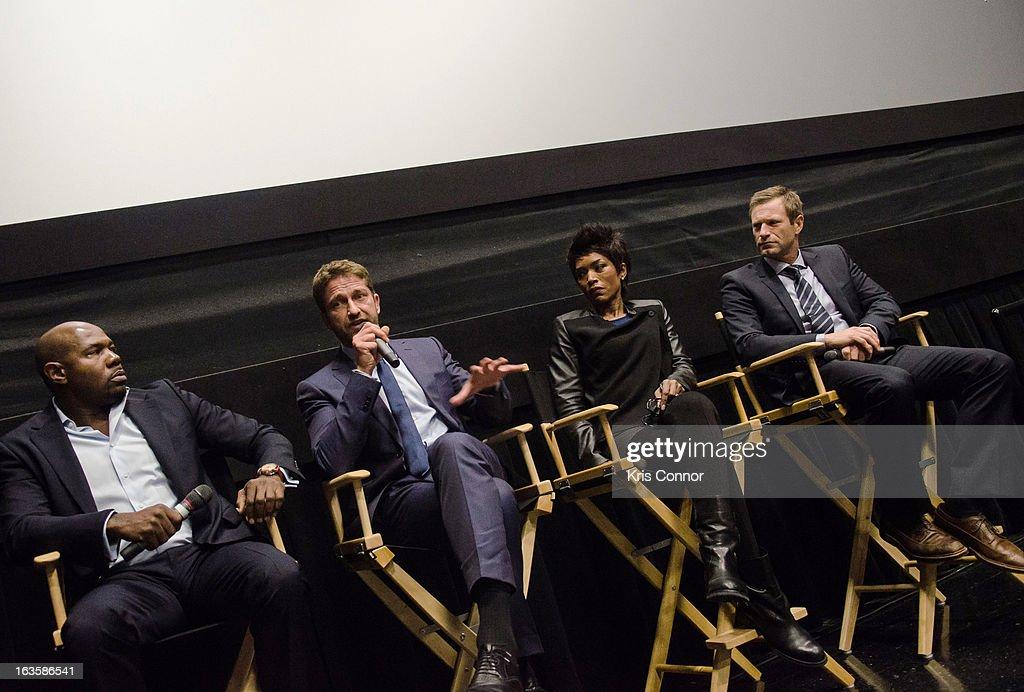 Antoine Fuqua, Gerard Butler, Angela Bassett and Aaron Eckhart speak during the 'Olympus Has Fallen' screening at AMC Loews Georgetown 14 on March 12, 2013 in Washington, DC.