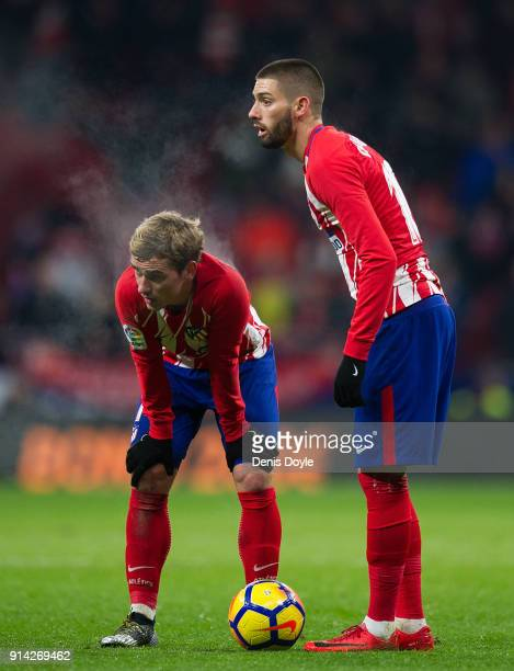 Antoine Greizmann and Yannick Carrasco of Atletico de Madrid get ready to take a free kick during the La Liga match between Atletico Madrid and...