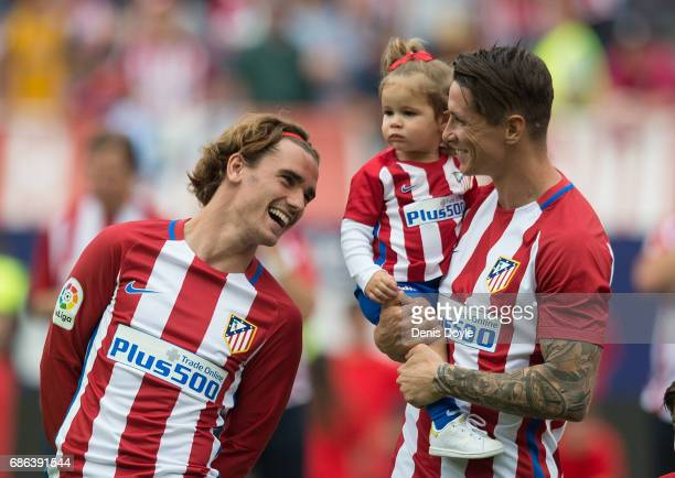 Antoine Greizmann chats with Fernando Torres with his daughter Elsa at the end of the La Liga match between Club Atletico de Madrid and Athletic Club...