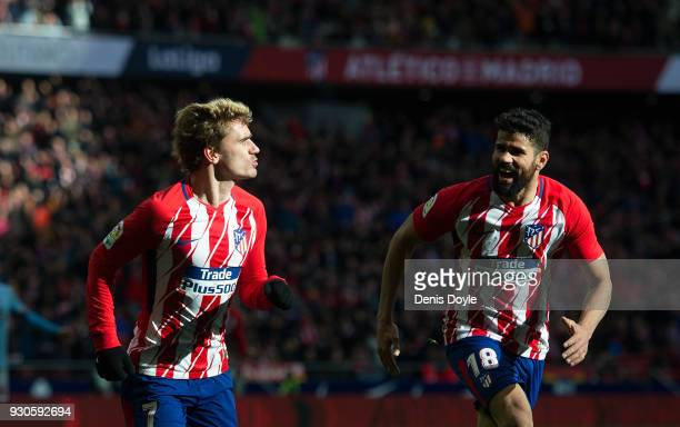 Antoine Greizmann of Atletico de Madrid celebrates with Diego Costa after scoring his team's opening goal during the La Liga match between Atletico...