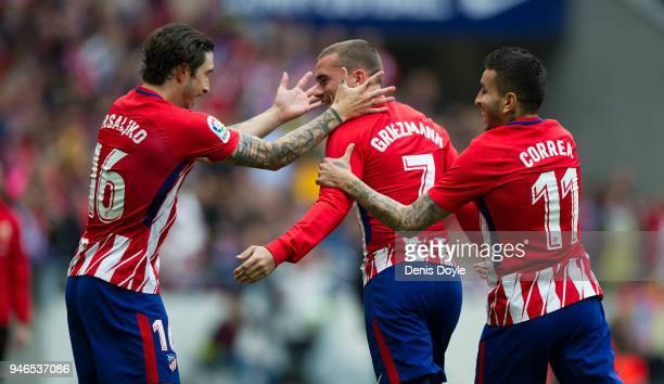 Antoine Greizmann of Atletico de Madrid celebrates with Sime Vrsaljko and Angel Correa after scoring his teamÕs second goal during the La Liga match...