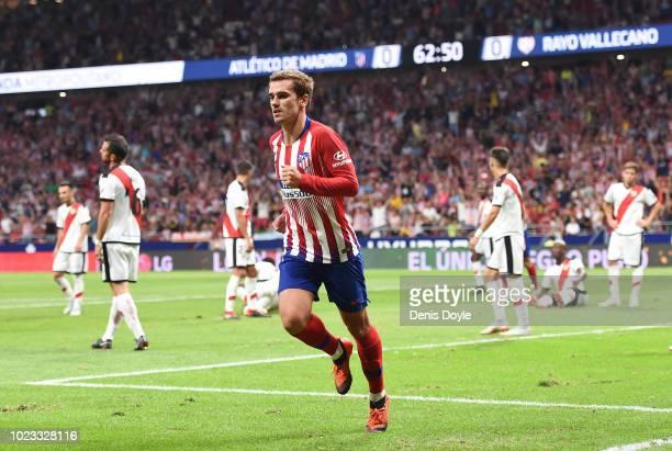 Antoine Greizmann of Club Atletico de Madrid celebrates after scoring his teams second goal during the La Liga match between Club Atletico de Madrid...