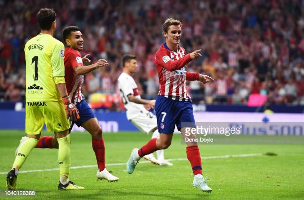 Antoine Greizmann of Club Atletico de Madrid celebrates after scoring his team's opening goal during the La Liga match between Club Atletico de...
