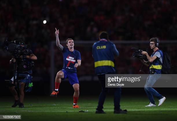 Antoine Greizmann of Club Atletico de Madrid celebrates Atletico's UEFA Super Cup victory over archrivals Real Madrid at the end of their La Liga...