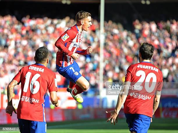 Antoine Greizmann of Club Atletico de Madrid celebrates scoring his team's opening goal during the La Liga match between Club Atletico de Madrid and...