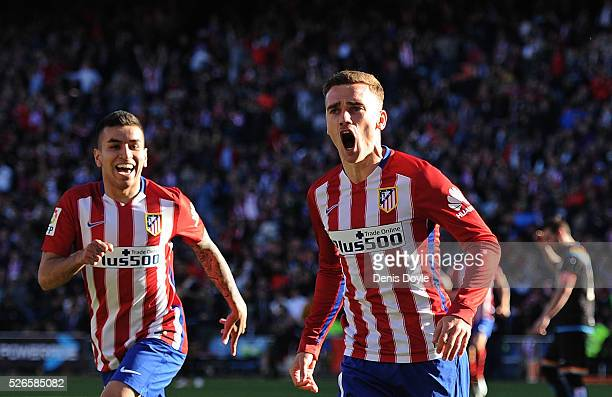 Antoine Greizmann of Club Atletico de Madrid celebrates scoring his team's opening goal during the La Liga match between Club Atletico de Madrid and...