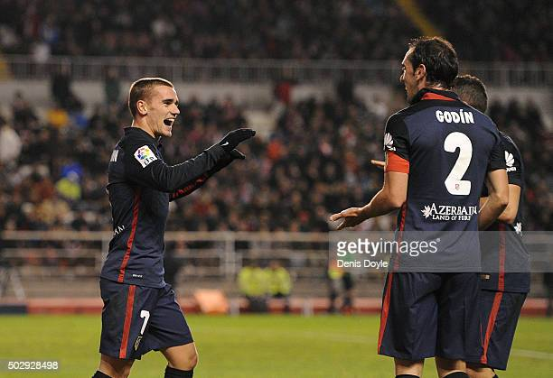 Antoine Greizmann of Club Atletico de Madrid celebrates with Diego Godin after scoring Atletico's 2nd goal during the La Liga match between Rayo...