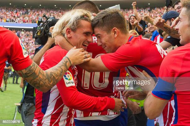 Antoine Greizmann of Club Atletico de Madrid celebrates with fans after his side scored their first goal during the La Liga match between Atletico...
