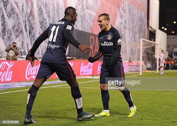 Antoine Greizmann of Club Atletico de Madrid celebrates with Jackson Martinez after scoring Atletico's 2nd goal during the La Liga match between Rayo...