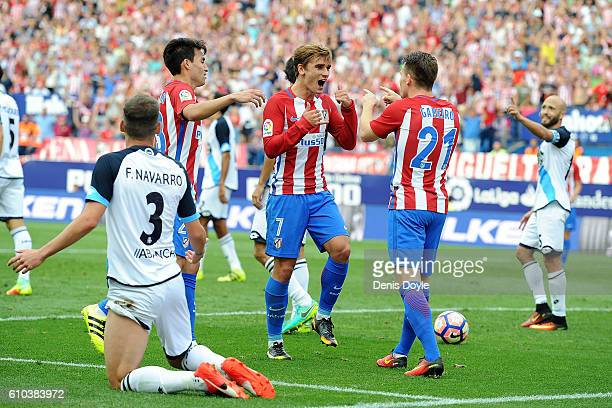 Antoine Greizmann of Club Atletico de Madrid celebrates with Kevin Gameiro after scoring his team's opening goal during the La Liga match between...