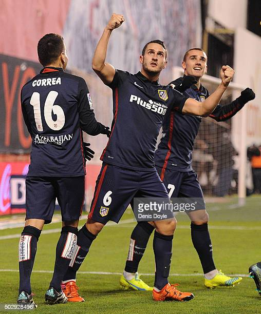 Antoine Greizmann of Club Atletico de Madrid celebrates with Koke and Angel Correa after scoring Atletico's 2nd goal during the La Liga match between...