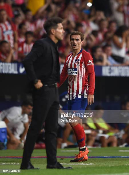 Antoine Greizmann of Club Atletico de Madrid has a word with Manager Diego Simeone of Club Atletico de Madrid after being substituted during the La...
