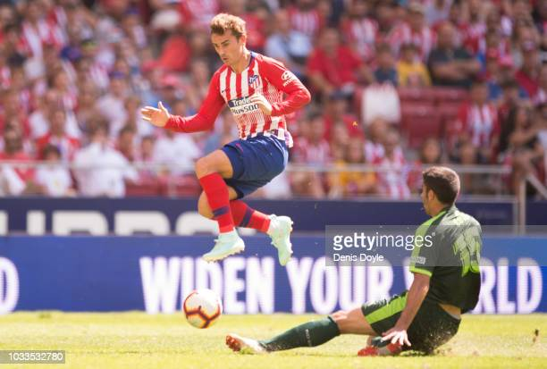 Antoine Greizmann of Club Atletico de Madrid is challenged by Jose Angel Valdes alias Cote during the La Liga match between Club Atletico de Madrid...