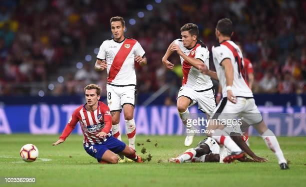 Antoine Greizmann of Club Atletico de Madrid is taken down by Luis Advincula of Rayo Vallecano de Madrid during the La Liga match between Club...