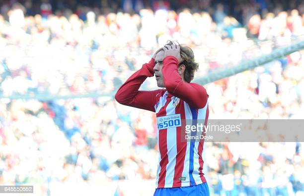 Antoine Greizmann of Club Atletico de Madrid reacts after his teammate Koke failed to score from his pass during the La Liga match between Club...