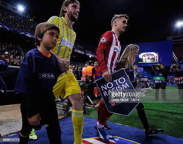 Antoine Greizmann of Club Atletico de Madrid takes to the pitch holding a ''No to Racism'' pennant during the UEFA Champions League Group C match...