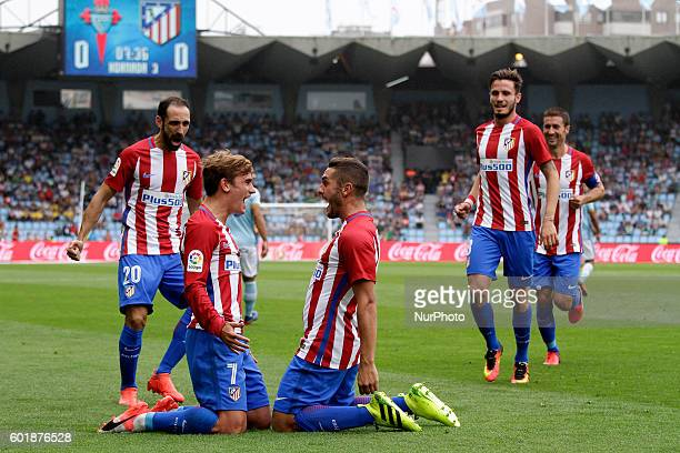Antoine Griezman and Koke celebrates a goal during the Spanish league football match Real Club Celta de Vigo vs Club Atlético de Madrid at estadio...