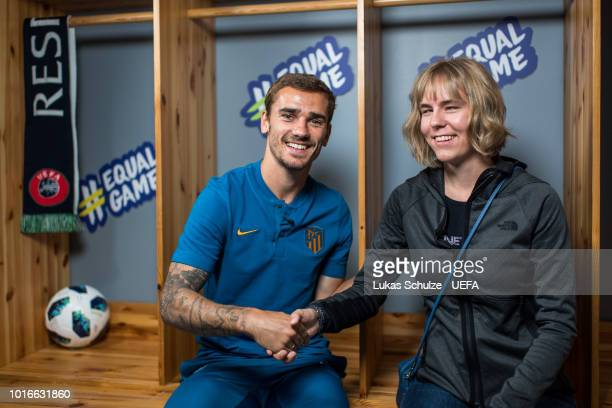 TALLINN ESTONIA AUGUST Antoine Griezman of Atletico Madrid talks to Merilyn Jaeski of the UEFA Foundation ahead of Atletico Madrid's training session...