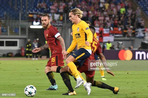 Antoine Griezman of Club Atletico de Madrid in action against Daniele De Rossi of AS Roma during the UEFA Champions League Group C soccer match...