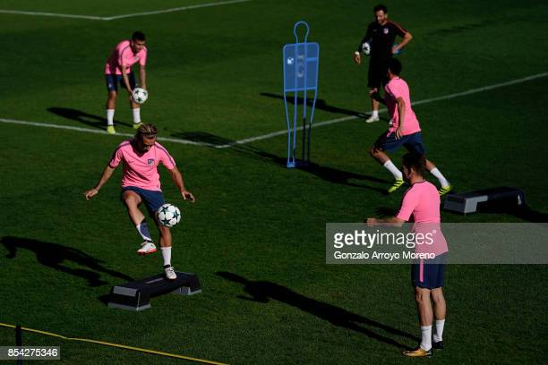 Antoine Griezmann 2ndL of Atletico de Madrid excersises with his teammates during a training session on the eve of the UEFA Champions League Group C...