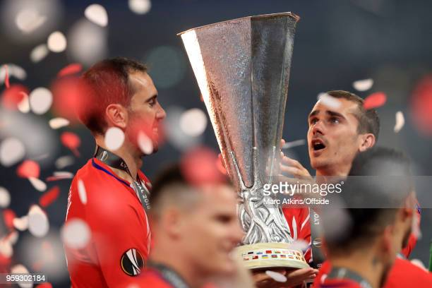 Antoine Griezmann and Diego Godin of Atletico Madrid celebrate with the trophy during the UEFA Europa League Final between Olympique de Marseille and...