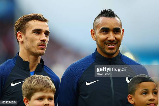 Antoine Griezmann and Dimitri Payet of France line up for the national anthem prior to the UEFA Euro 2016 Group A match between France and Romania at...