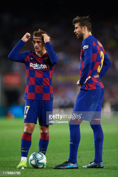 Antoine Griezmann and Gerard Pique of FC Barcelona look on during the Liga match between FC Barcelona and Villarreal CF at Camp Nou on September 24,...