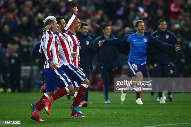 Antoine Griezmann and Jesus Gamez of Atletico Madrid celebrate victory after the penalty shoot out during the UEFA Champions League round of 16 match...