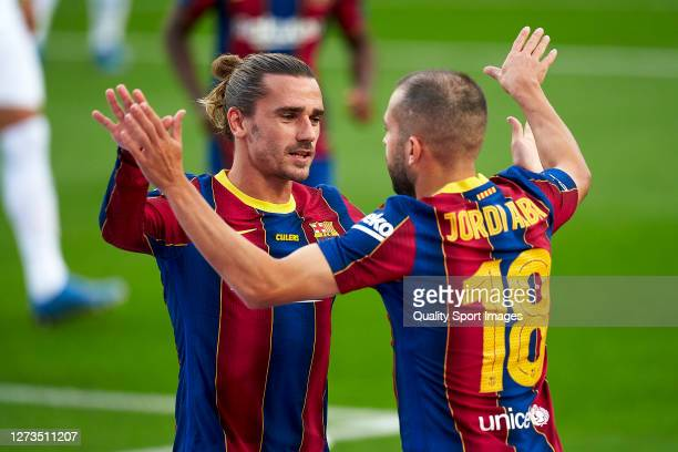 Antoine Griezmann and Jordi Alba of FC Barcelona celebrating their team's first goal during the Joan Gamper Trophy match between FC Barcelona and...