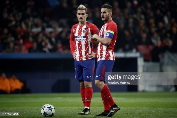 Antoine Griezmann and Koke of Atletico Madrid are seen during the UEFA Champions League Group C match between Atletico Madrid and AS Roma at the...