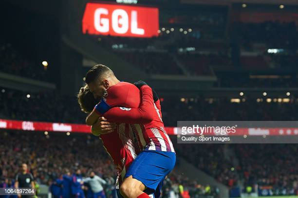 Antoine Griezmann and Koke Resurreccion of Atletico de Madrid celebrate during the La Liga match between Club Atletico de Madrid and FC Barcelona at...