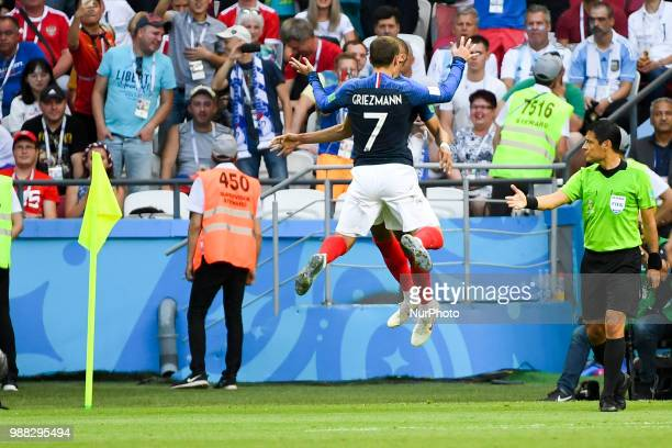 Antoine Griezmann and Kylian Mbappe of France celebrate scoring during the 2018 FIFA World Cup Round of 16 match between France and Argentina at...