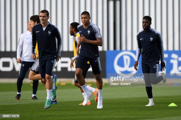 Antoine Griezmann and Kylian Mbappe of France warm up during a France training session during the 2018 FIFA World Cup at Luzhniki Stadium on July 14...