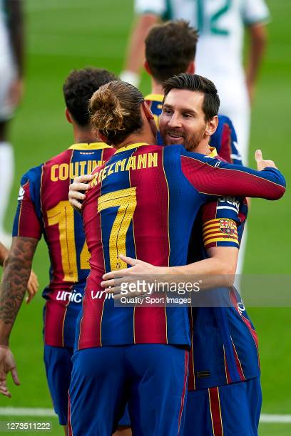 Antoine Griezmann and Lionel Messi of FC Barcelona celebrate their team's first goal during the Joan Gamper Trophy match between FC Barcelona and...