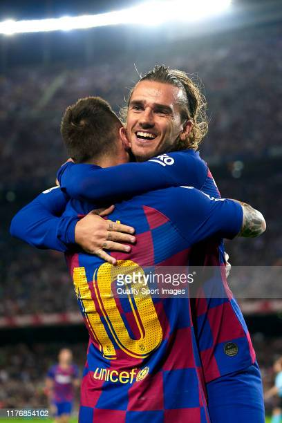 Antoine Griezmann and Lionel Messi of FC Barcelona celebrating their team's first goal during the Liga match between FC Barcelona and Villarreal CF...