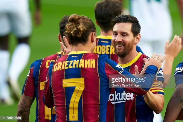 Antoine Griezmann and Lionel Messi of FC Barcelona celebrating their team's first goal during the Joan Gamper Trophy match between FC Barcelona and...