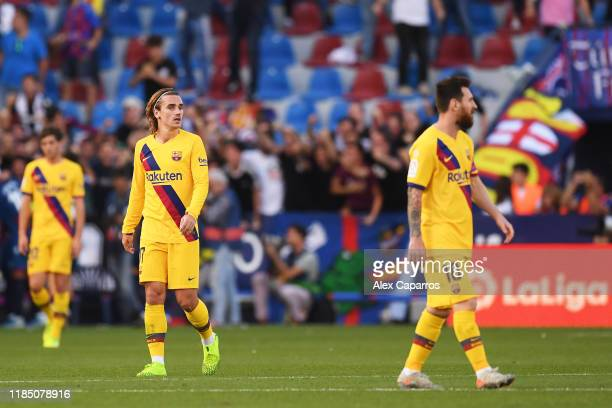 Antoine Griezmann and Lionel Messi of FC Barcelona react during the Liga match between Levante UD and FC Barcelona at Ciutat de Valencia on November...