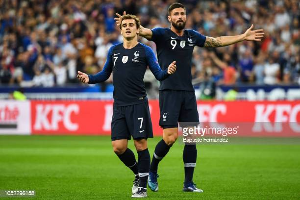 Antoine Griezmann and Olivier Giroud of France react during the UEFA Nations League A group one match between France and Germany at Stade de France...