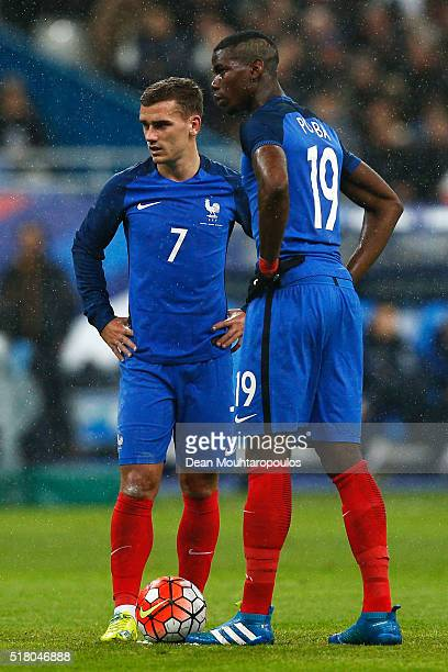 Antoine Griezmann and Paul Pogba of France speak before taking a free kick on goal during the International Friendly match between France and Russia...