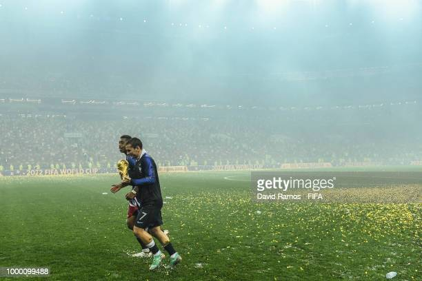 Antoine Griezmann and Presnel Kimpembe of France celebrate with the World Cup Trophy following his side victory in the 2018 FIFA World Cup Russia...