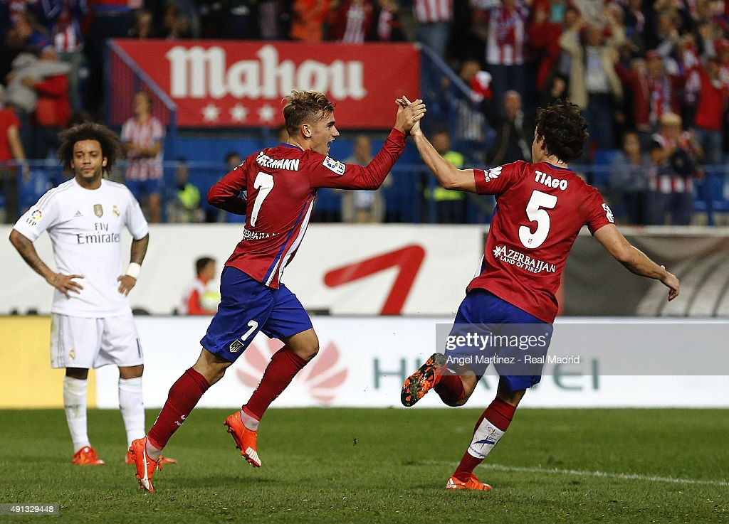 Antoine Griezmann (L) and Tiago of Atletico de Madrid celebrate the equalising goal during the La Liga match between Club Atletico de Madrid and Real Madrid CF at Vicente Calderon Stadium on October 4, 2015 in Madrid, Spain.