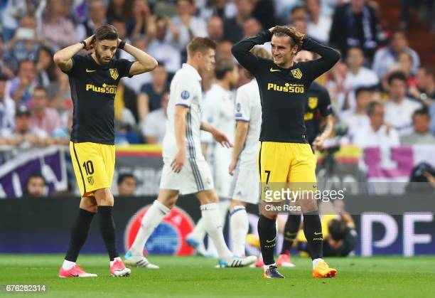 Antoine Griezmann and Yannick Ferreira Carrasco of Atletico Madrid react during the UEFA Champions League semi final first leg match between Real...