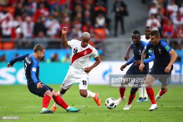Antoine Griezmann Blaise Matuidi and Lucas Hernandez of France compete with Andre Carrillo of Peru during the 2018 FIFA World Cup Russia group C...