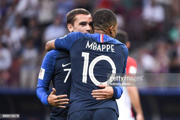 Antoine Griezmann celebrates a goal with Kylian Mbappe of France during the World Cup Final match between France and Croatia at Luzhniki Stadium on...