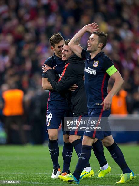 Antoine Griezmann celebrates their victory with teammates Lucas Hernandez Pi and Gabi Fernandez after the UEFA Champions League quarter final second...