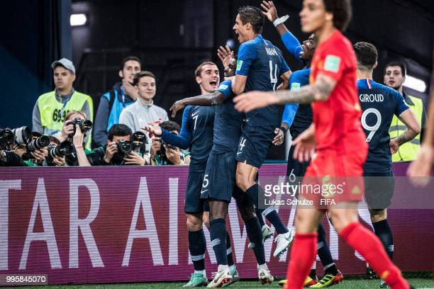 Antoine Griezmann celebrates with team mates their teams first goal scored by Samuel Umtiti during the 2018 FIFA World Cup Russia Semi Final match...