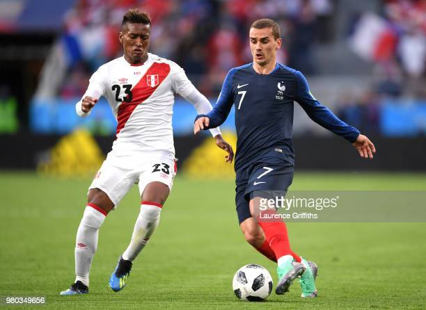 Antoine Griezmann challenge for the ball with Pedro Aquino of Peru during the 2018 FIFA World Cup Russia group C match between France and Peru at...