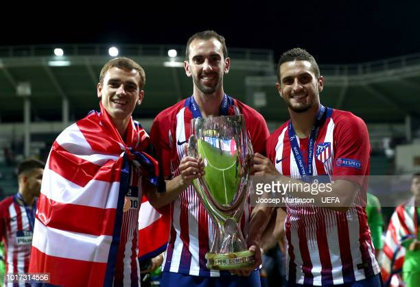 Antoine Griezmann Diego Godin and Koke of Atletico Madrid celebrate victory with the trophy following the UEFA Super Cup between Real Madrid and...