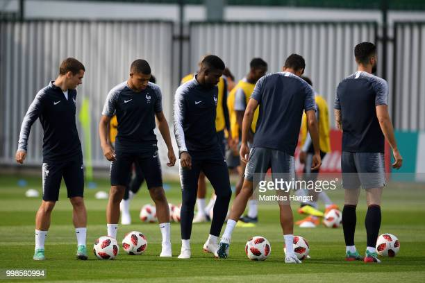 Antoine Griezmann Kylian Mbappe and Samuel Umtiti of France attend a France training session during the 2018 FIFA World Cup at Luzhniki Stadium on...