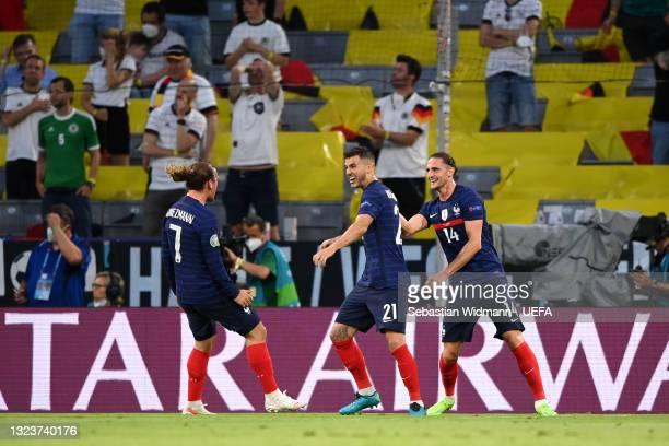 Antoine Griezmann, Lucas Hernandez and Adrien Rabiot of France celebrate their side's first goal, an own goal by Mats Hummels of Germany during the...